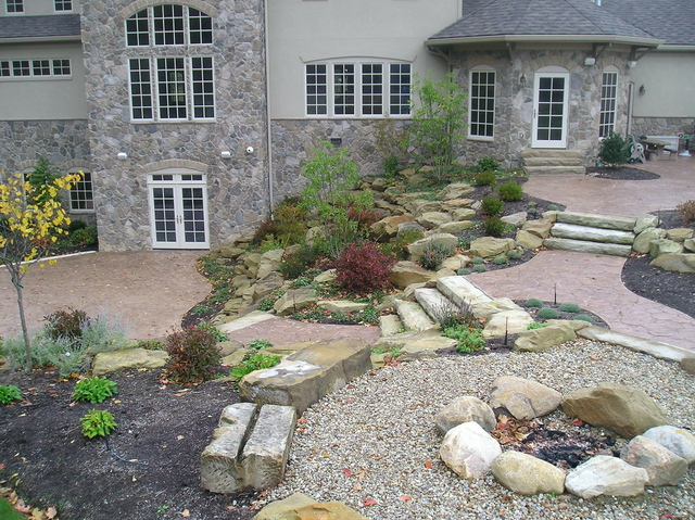 mountain landscaping, boulders, steps, wall