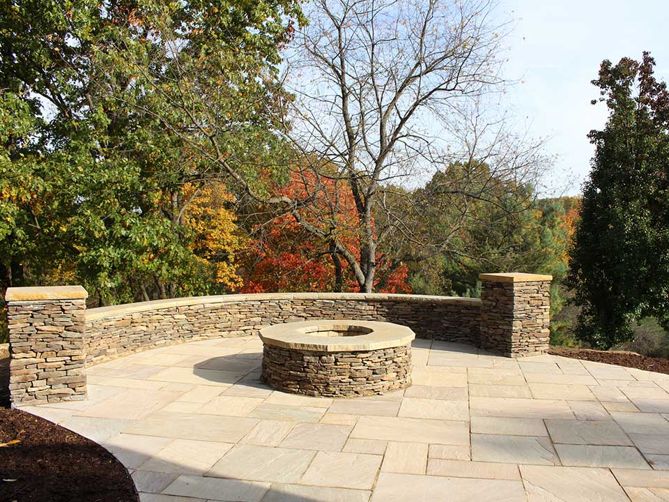 Stone fire pit, paver patio, trees, hendersonville